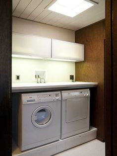 base w/ storage, laundry machines, and other good ideas - maybe as a way to deal w/ space needed by venting duct?