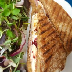 Bacon cranberry and cornish brie in malted panini