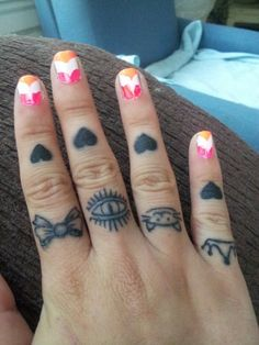 knuckle tattoos.....the bow and the cat...but probably a bit different for me....