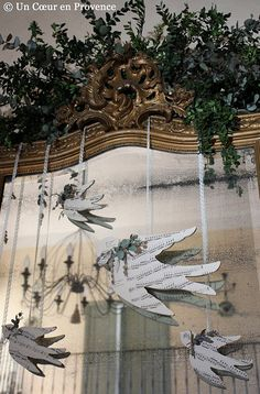 This would look great as a wall design. It would be cute hanging over a window too. I love the fact that the paper doves pictured are made out of music sheets and hanging from ribbons.