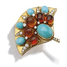 18 Karat Gold, Citrine, Turquoise and Diamond Brooch, Bulgari Designed as a lotus flower, set with turquoise and citrine cabochons, accented by round diamonds weighing approximately .70 carat, gross weight approximately 12 dwts, signed Bulgari, with French assay marks; circa 1970.