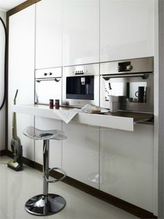 Industrial kitchen design with a hidden eat-in space