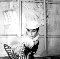 Model wearing a hat by Givenchy, 1954. Photo by Henry Clarke.