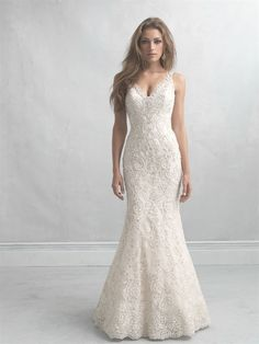 Allure Bridals: Style: MJ15 This gown is nothing short of incredible. The scalloped beaded lace is beautiful on its own, but the back not only features a modified keyhole opening but a gauzy train of English net.  Colors: White/Silver, Ivory/Silver, Gold/Ivory/Silver Sizes: 2-32 Fabric: Lace and English Net