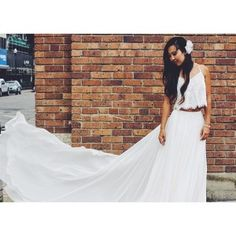 Martina Liana's boho wedding dress style features the fine beaded tulle Tyler top and the sexy Sanja skirt. The bridal skirt zips up & flows into a long train.