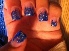 Blue acrylic tipped gel nail. Glittery blue with large white  chunky  glitter