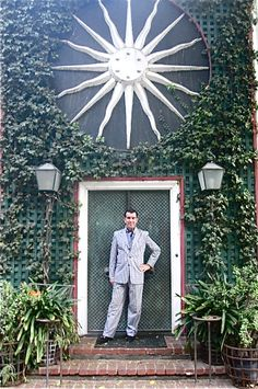 Hutton Wilkinson stands in front of Tony Duquettes Iconic Dawnridge.   dovecotedecor.com