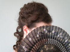 This is a tutorial for a Late Victorian hairstyle. Enjoy!! Let's begin. Step one ~ Part the front section of your hair beginning from behind your ears to the top of your head on both sides, then ti...