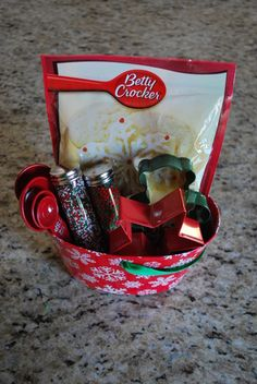 Cute gift idea...cookie mix, cookie cutters, sprinkles and measuring spoons in a container...you could easily add to this idea...spatulas, cookie sheet, and put it in a set of mixing bowls...wooden spoons...limitless!