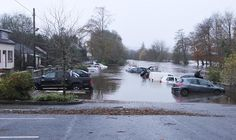 Several cars have been left destroyed after the River Finn burst its banks and flooded the carpark of Jackson's Hotel in Ballybofey overnight. Pic by Northwest Newspix.