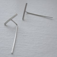 Simple and Modern enough to be worn on a daily basis. These tiny 11mm bars are soldered with solid 25mm sterling silver posts. Earring backs are