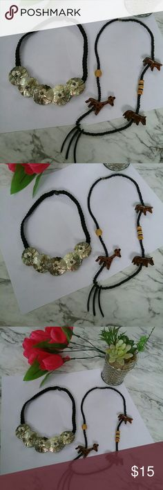 Two Vintage STYLE Wood Shell Beaded Necklace This is a beautiful set of two vintage style necklaces one has wooden beads with animals what looks like a giraffe possibly. The other is a black nylon cording with shell floral adornments. It is just a nice set of costume Jewelry Unbranded Jewelry Necklaces