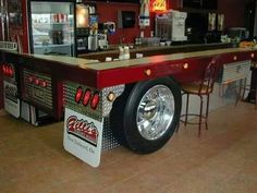 Semi trailer BAR: look at its simple construction. Some diamond plate, bar top, mud flap, and a tire/rim affixed to the bar Car Part Furniture, Automotive Furniture, Automotive Decor, Furniture Ideas, Furniture Design, System Furniture, Furniture Chairs, Recycled Furniture, Handmade Furniture