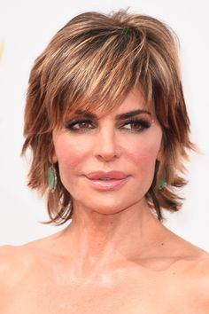Lisa Rinna stuck to her signature layered razor cut when she attended the Emmys......without the bangs