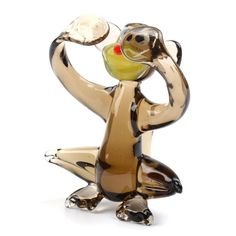 """""""No-See Brown #Monkey Glass Figurine Item No. GF00252A01 $13.29 This No-See Brown Monkey Glass Figurine is hand blown and imported from Russia. It's bright colors and adorable shape is sure to delight! Because each figurine is crafted by hand no two are exactly alike."""" Blown Glass Art, Glass Figurines, Bright Colors, Monkey, Russia, Miniatures, Shapes, Brown, Cute"""