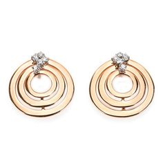 These 18kt rose and white gold earrings, from the Sophia Loren Collection by Damiani, feature 3 circles of gold and round cut diamonds with a total carat weight of .36, colour grade H and clarity VVS.