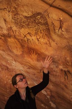 "The roughly 8,000-year-old ""hands"" painted on a rock wall in the Sahara Desert aren't human at all, as researchers originally thought, but are actually stencils of the ""hands"" or forefeet, of the desert monitor lizard, a new study finds."
