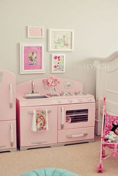 ...natalia's room is so similar to this (down to the colors, flower balls, and rag banner)! wow! ...can't wait to add the (yikes- same) kitchen!