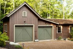 "The barn-inspired garage attaches to the main house via a enclosed passageway. Paint Color: Garage doors are ""Sherwin Williams Garden Gate SW6167″ and the trim is ""Sherwin Williams Saw Dust SW6158″. Garage Design Ideas. Barn Style Garage. #Garage"