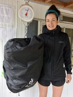 Kathleen weighing pack at end of West Coast Trail