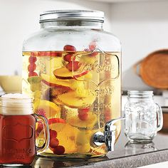 Mason Jar Dispenser | dotandbo.com - I've been looking for one of these with a metal spigot instead of plastic.