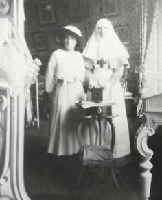 "Grand Duchess Anastasia and Tatiana Nikolaevna Romanova of Russia taking a ""selfie"" in their mother's bedroom,using her mirror.A♥W"