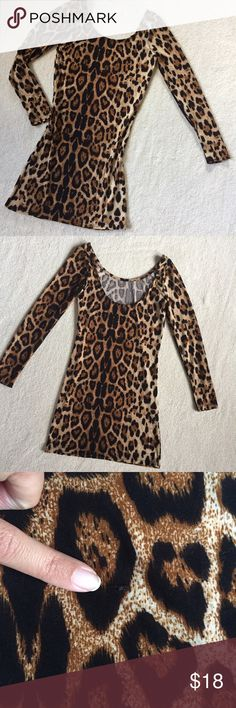 "Animal Print Bodycon Dress Animal Print Bodycon Dress  NWT Sexy, leopard print dress. Really soft material. One small pull (pictured). No size on the label but it measures like a Small. Length 31"" Bust 28"" Waist 25"" Hip 28"" Sleeve Length 22"" Dresses"