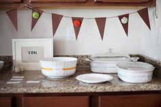 love the white dishes & simple labels attached w/ colored ribbons.