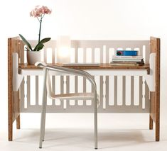 Clever crib! Besides converting into a toddler bed, it then converts into a play table and/or desk! Brilliant!