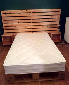 DIY Pallet Bed with Shelved Headboard