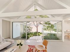 White Twin Gable House by Ryan Leidner Architecture is a remodeled Eichler