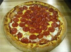 Oggi's Sports/Brewhouse/Pizza: Hand-tossed thick French Bread Crust style that's light and fluffy in the middle and made fresh daily. Topped with 100% California whole milk mozzarella cheese and Hormel pepperoni.  www.oggis.com