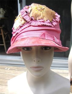 http://www.ebay.com/itm/20s-LADY-SUPREME-PINK-DECO-CLOCHE-WITH-VELVET-TRIM-AND-FLOWERS-HAT-STAND-/171368692132?pt=LH_DefaultDomain_0