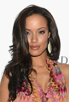 Selita Ebanks shows off her voluminous hair and sultry makeup.