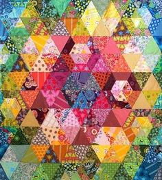 Patchwork Prism Quilt by Anna Maria Horner. Download the free pattern here http://www.janomespecials.com/annamaria/projects.html#PatchworkPrismQuiltProject