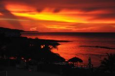 Sunset from the Infinity Bar, following a day of downpours at the Grand Palladium Lady Hamilton, Lucea Jamaica