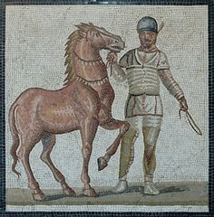 A charioteer belonging to the White (albata) faction, with his horse.  Pavement mosaic from the Villa dei Severi at Baccano, Italy, first half of 3rd century CE.  Now in the National Museum of Rome at the Palazzo Massimo delle Terme.