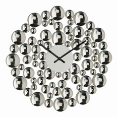 Looking like a mass of free-floating bubbles, this delightful polished metal wall clock appears to be lighter than air. Cleverly constructed with no visible joins, each shiny silver bubble seems like it might just float off on its own at any moment.