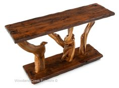 Handcrafted log furniture for cabin, lodge, western, ranch & mountain decors.  Woodland Creek Furniture