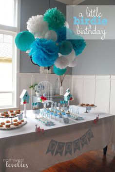 Bird birthday party: shades of blue i like the paper balls over the chandelier idea