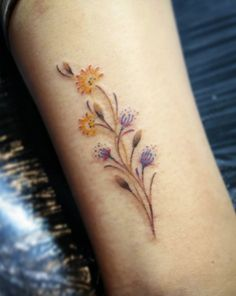 Flowers on ankle by Holly Walsh