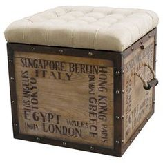 "Add a charming touch to your living room or den with this cube-shaped ottoman, showcasing a tufted cushion top and typographic detailing.   Product: Ottoman  Construction Material: Wood, rope and fabricColor: Natural and cream  Features:  Tufted  Two rope side handles  Dimensions: 22"" H x 20"" W x 20"" D"