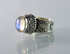 Blue Fire Rainbow Moonstone 925 Solid Sterling Silver Ring    Metal: 925 Solid Sterling Silver    Stone Used: Genuine Rainbow Moonstone    Stone Shape: Oval Cab    Stone Size: 11 x 9 mm    Stone Color: White With Blue Fire.   Shop this product here: http://spreesy.com/navyacraft/66   Shop all of our products at http://spreesy.com/navyacraft      Pinterest selling powered by Spreesy.com