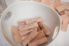this couple had guests write advise on Jenga pieces!  how fun :) #MinneapolisWeddingPhotographers