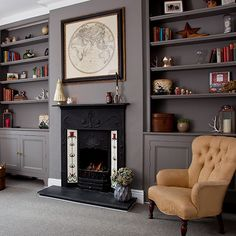 Grey traditional living room with fireplace and alcove shelving is part of Living Room Shelves Offices - Decorate your living room in a palette of deep greys for a cocooning effect Alcove Ideas Living Room, Living Room Shelves, Living Room Storage, Living Room With Fireplace, Living Room Grey, Home Living Room, Living Room Designs, Living Room Decor, Room Ideas