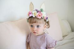 This Crown can be customizable for colors. Please make request at time of purchase or I will make in Ivory and Pink flowers, as per the single photos taken (not on child) Flowers are mounted on Natural Jute rope. Ears are made from Felt. Headband is adjustable and will fit any size baby, toddler or Mamas head. Just slip ends through loop and pull to fit head. Back of flowers are covered with felt for extra comfort. This Flower Crown is perfect for 1st birthday or make believe play, or photo…