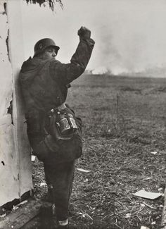 rationalistatheist: A young Waffen-SS NCO signals his men to close up.