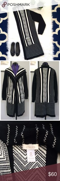 """Drape Front Sweater • Long Black & White Cardigan This stunning graphic composition of bold black & white stripes will make this your favorite go-to sweater during the cooler months with its seasonally-appropriate, long silhouette and flyaway opening!   Brand: Chico's Chico's Size 0 (Standard Size: Small) Length: 34"""" 55% Cotton 45% Acrylic Chico's Sweaters Cardigans"""