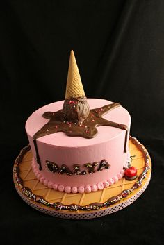 Butter cream cake with melted ice cream cone by Andreas SweetCakes, via Flickr