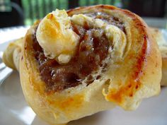 Sausage Biscuit Pinwheels/ roll sausage link in a crescent roll-bake- cover with country gravy. Best sausage and gravy you will ever have